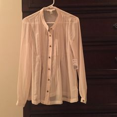 NWT Forever 21 sheer cream blouse NWT Forever 21 cream blouse with pearl buttons. Sheer top. Would look great with a tank under for work or a fun bra for play. Ready to negotiate! Please feel free to leave questions or comments. Smoke free clean home. Forever 21 Tops Blouses