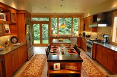 From HGTV Remodels... Warm colors, outdoor views... and I can't believe the table is black-stained concrete