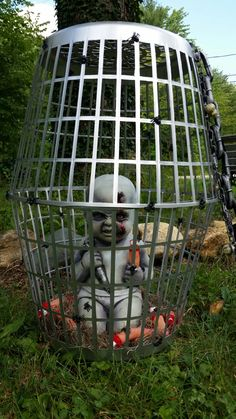 Halloween zombie  cage decoration. The cage is made from dollar store laundry baskets.