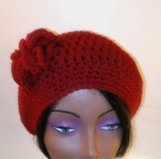 """This crochet hat/beanie is made is soft acrylic yarn.  It has a gorgeous flower adorning the right side and matching boot cuffs.  The hat does not have elastic in the band, but will snugly fit a head measuring 21"""" in circumference.      These boot cuffs can be worn with ankle boots, calf high boots or knee length boots.  They measure 6' in width and approximately 4"""" in length.  They can be worn inside your boots, as pictured, or outside.      (The boots picture are not included with your…"""
