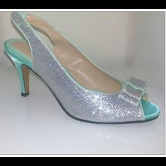 GORGEOUS SILVER GLITTER/MINT HEELS Brand New From Boutique Silver Glitter/Mint Heels. I have various sizes available. Comment the size you need and I can make a separate listing! These are stunning for a wedding, a cocktail party, birthday or any day! They fit true to size. Shoes Heels