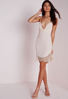 We are totally addicted to lace here at Missguided and this nude number is a total dreamboat. With chic v neckline, and fanciful lace to the waist and hem this dress will give you a killer silhouette. Team with nude lace up strappy heels an...