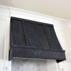 Create your own range hood using paint and inexpensive tacks.