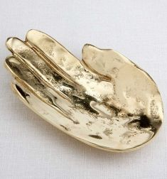 KELLY WEARSTLER | PALM DISH. Spirited burnished bronze catch all