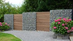 Awesome Modern Fence Design If people say that wooden fences are customizable, they really want it! You might be surprised to see how many different and unique fence designs are there! Gabion Fence, Gabion Wall, Timber Fencing, Modern Fence Design, Walled Garden, Garden Fencing, Garden Beds, Backyard Landscaping, Garden Inspiration