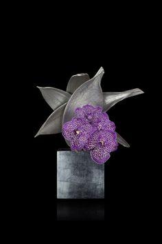 Purple vanda orchid and silver coconut leaves on silver laquer vase| Armani/Fiori