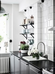Modern Scandinavian kitchen, black and white interior design with green plants and flowers. Corner Sink Kitchen, Kitchen Cabinet Design, Interior Design Kitchen, Kitchen Dining, Kitchen Decor, Granite Kitchen Counters, Black Countertops, Tile Counters, Sweet Home