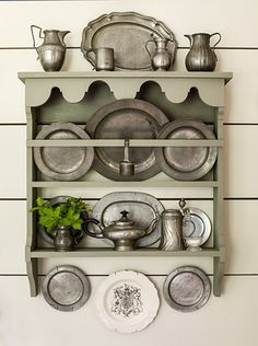 grey painted shelf to hold your collectibles