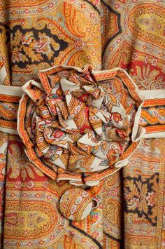 detail, orange floral and paisley dressing gown, c. 1869. Charleston Museum.