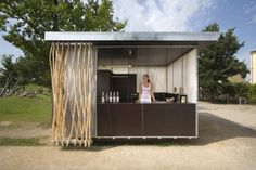 Completed in 2009 in Potsdam, Germany. Images by Stefan Günther. The Kiosk is located in the Park of the Bundesgartenschau in Potsdam, Germany. As an extension to an existing café it is selling ice cream, lemonade. Kiosk Design, Cafe Design, Booth Design, Store Design, Signage Design, Design Design, Graphic Design, Food Stall Design, Information Kiosk