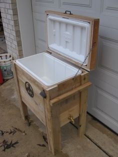 """Cowboy Cooler"" Made out of pallet lumber. The spigot ties in to the drain on the cooler."