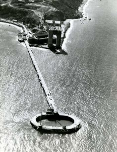 September 1934 - An aerial view of the fender wall for the South pier of the Golden Gate Bridge (fender is the O out in the water). Famous Buildings, Unique Buildings, Famous Bridges, Famous Landmarks, San Francisco California, San Francisco Bay, Old Pictures, Old Photos, Bay Area Bridges