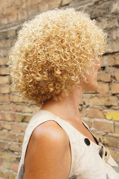 very tight perm with nicely shaped style