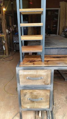 Quick in process pic of a desk/console with 2 storage and 2 filing drawers plus overhead shelving. Built by Metal Fred