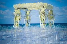 Stunning beach ceremony with  custom flower canopy from Monaco couple Melissa & Dean's destination wedding in Miami. Wedding planned and designed by Tiffany Cook.