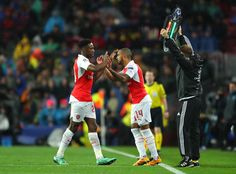 Theo Walcott of Arsenal is brought in for Danny Welbeck during the UEFA Champions League round of 16, second Leg match between FC Barcelona and Arsenal FC at Camp Nou on March 16, 2016 in Barcelona