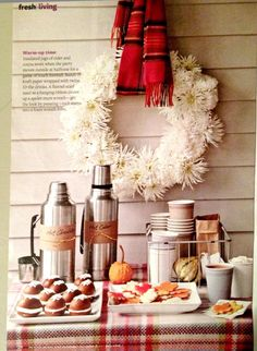 Plaid table cloth. Rustic look. Cider and hot cocoa. Take away the wreath and this could be great for summer.