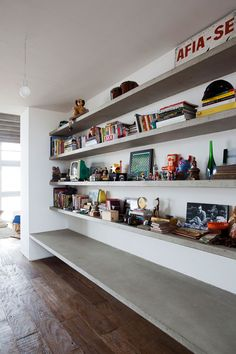holy concrete shelves, batman! also, the finish on this floor is identical to our apartment. amazing.