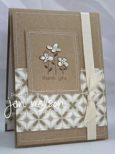 handmade card ... kraft paper makes a neutral card ... like this design with three sweet flowers on a panel stitch framed with three lines ...