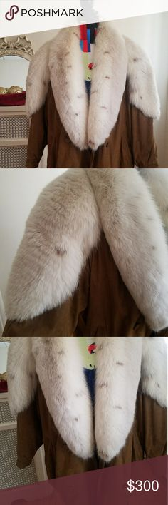 Vintage women's Leather Coat with Fox Fur the fur is very thick and plush and luxurious  The leather is not suede but is soft leather, not stiff. There are a few marks and mild distressing to the leather but it looks overall very good! Jackets & Coats Puffers