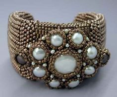 Love the way the pearls are bezeled with beads in this bracelet.  I'm guessing it is by Maggie Meister but it's on Marcia DeCoster's blog from March, 2009