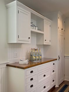 two cabinets with shelves in between and crown moulding.  Super look!