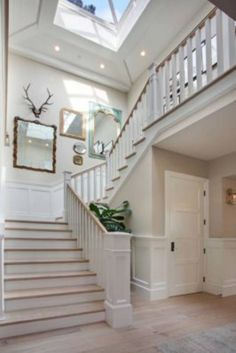 Wide staircase, wainscoting, skylight and blonde flooring Open Staircase, Staircase Design, Stairs, Hallway Decorating, Interior Decorating, Interior Design, Escalier Design, Design Case, House Goals