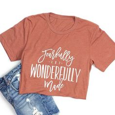 "A ""fearfully and wonderfully made"" design on a clay unisex tee with a white…"