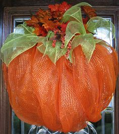 Deco Mesh PUMPKIN WREATH. Finished size 25x23.  I am going to do this basic idea, but slightly different for my house. AND TWO of them for either side of the door.  Add more black.