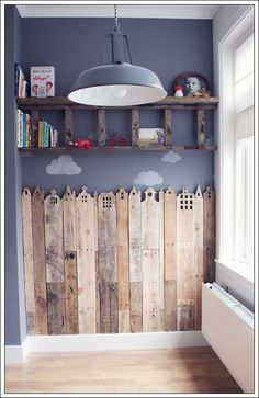 Super cure wooden fence wall for play room. mommo design: LADDER LOVE love the ladder shelf but even more so love the pallet city scape. would be great behind boys beds for superhero room Pallet Projects, Home Projects, Diy Pallet, Pallet Wood, Pallet Kids, Pallet Boards, Fence Boards, Pallet Fence, Pallet Nursery Ideas