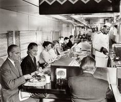 Dining car travel. Oh, the Golden Age of Travel. Elegant meals served with fancy dinnerware. What a way to travel.