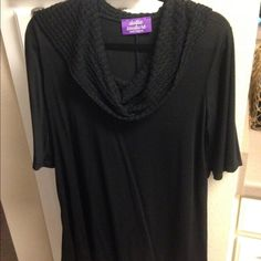 Short sleeve cowl neck shirt. Black short sleeve shirt. Has a cowl neck, great with a sweater. Flowy and long in length. Never worn. NWOT. Boutique find! Tops Tees - Short Sleeve