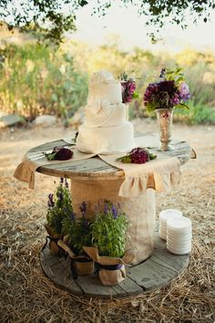 Rustic Table for Farm Wedding Cake. I would add a tablecloth under the burlap maybe!