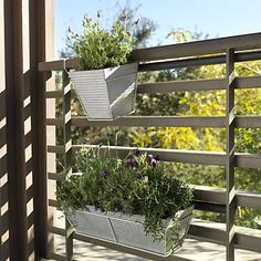 Horizontal fence oscar planters by CB2