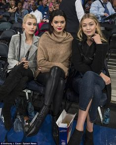 A trio of beauties: Kendall looked the height of glamour as she posed with Hailey and Gigi...
