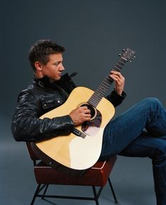 Jeremy Renner. Piano and guitar? He went up a few points on my cool meter.