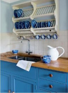 I like the idea of showing off the plates. It works especially well for small kitchen spaces. Country cottage style decor in the Somerset English home