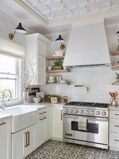 All white kitchens with graphic tile flooring. Perfection!