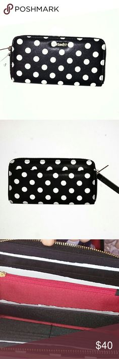 """OLIVIA+JOY BLACK WALLET - NWT NWT. BLACK AND WHITE POLKA DOT ZIP AROUND WALLET.Main interior pocket features 12 card slots, 2 slip pockets, and zippered coin pocket. Size: 8""""W x 4.5""""H x 1""""D INSIDE IS BLACK WITH SOME RED .OLIVIA+ JOY NAME IS IN FRONT IN GOLD COLOR.. VERY CUTE AND BEAUTIFUL WALLET. Faux Leatherzip closure. Zip Around closure wallet. Polka Dot Faux Leather. Gold tone hardware detail. Olivia + Joy Bags Wallets"""