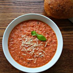 This Tomato Basil Soup uses plain Greek yogurt to thicken it up instead of cream!  Using fire roasted tomatoes, it's an easy weeknight meal.