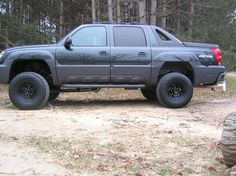 """2002 Black Chevy Avalanche has a 6"""" lift with 35"""" tires"""