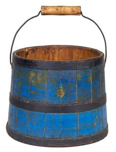 "Willis Henry Shaker Auction 9/10/16 Lot 249 (1 of 2). Estimate: $600 - 900. Realized: $510. Desc: Two Pails, Pine, original dark blue paint, 3 steel bands painted black, with arrow point shaped ends, steel wire & wood swing handle, diamond bail plates, c. 1850-60, 7 1/2″ h (to rim), 8″ dia; Pine sap bucket, original red paint, white washed interior, metal hanger attached at rim, original steel bands moved, stamped on bottom ""Alfred Shakers"", 11″ h, 11 3/4″ dia."
