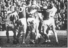 1965 FA Cup semi final clash with Man U as Collins, Law, Crerand, Bremner, Stiles and Hunter battle it out.