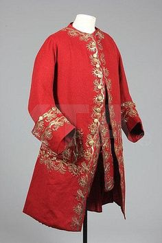 Frock coat and matching sleeved waistcoat, Scotland, c. 1745-1750. Scarlet superfine wool, elaborately embroidered with gilt thread and sequins, the buttons covered in interwoven metal strip, lined in crimson silk, with densely embroidered broad pocket flaps, decorative buttons to the sword slits; the matching waistcoat with linen upper lining, single buttons at the cuffs.
