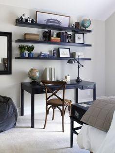 floating bookshelves over dresser | Bedroom with a dark wood desk with matching floating shelves, a mirror ...