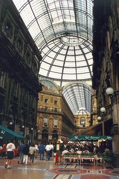 Milan's Galleria Vittorio Emanuele is the place where people come to talk, read their Corriere della Sera or drink a coffee. With its glass dome covering, it could be considered the first indoor shopping mall.
