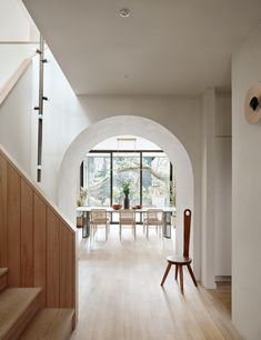 An archway separates the main living space from the rest of the ground floor. #dwell #modernarchitecture #austin #homerenovation #moderndesign