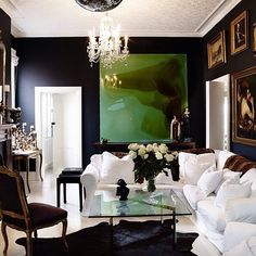 Bedroom idea? Dark navy walls with white bed linens and white headboard.