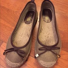 Michael Kors espadrille flats Great used condition. Only worn a few times which is why the sticker remained intact. Not sure if these are 8 or 8.5 because the sticker came off but they fit like an 8.5 which is why I'm selling at such a reduced price. Michael Kors Shoes Espadrilles