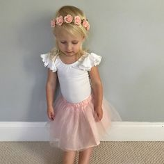 Sweet, simple flower girl or Easter dress up. White ruffle sleeve leotard by The Leotard Boutique.